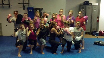 Precision Combat Sports combo cardio kickboxing and crossfit class. Photo by Kory Stone