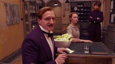 Ralph Fiennes, Saoirse Ronan, and Tony Revolori in Wes Anderson's The Grand Budapest Hotel. Image courtesy of Fox Searchlight
