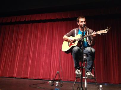 Brian O'Sullivan making laughs on the stage in the student center. Photo by Kaitlyn Conrad