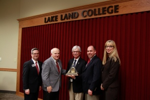 North American Lighting was recently was awarded the 2014 Business Partnership Award from Lake Land College for its ongoing exceptional partnership with the college. Pictured here from left to right are: Josh Bullock, president of Lake Land College; Mike Sullivan, chairman for the Lake Land College Board of Trustees; Greg Conrad, president and COO of North American Lighting; Kirk Gadberry, vice president of North American Lighting; and Amanda Martin, human resources manager at North American Lighting.