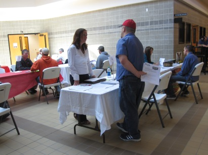 Deb Bohannon, representative from BEI Automotive Repair in Casey speaks with an automotive technology student at the Lake Land College Automotive Job Fair.