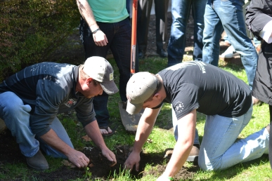On April 25, 2014, Tom Caldwell (left) and Paolo Mendez (right) dig up the time capsule from 1999 that was burried behind the Learning Resource Center. This was one of the last events of Lake Land's celebration of Give Life month.  Photo by Kaitlyn Conrad
