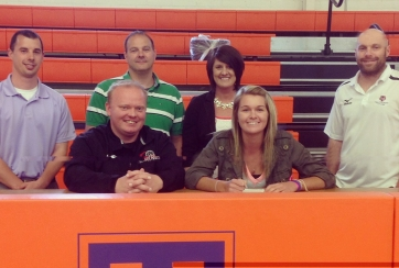 Abby Smith, Oakland, recently signed to play volleyball with Lake Land College for the 2014-2015 school year. Pictured here at her signing, in the back row, from left are: Tri-County Athletic Director Blake Doehring; David Smith, Oakland; Sherry Smith, Oakland; and Drew Robertson Tri-County volleyball coach. In the front row is Lake Land College volleyball coach Amory Porter and Abby Smith, Oakland.